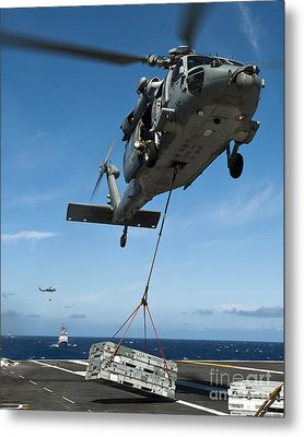 An Mh-60s Sea Hawk Helicopter Lowers Metal Print by Stocktrek Images