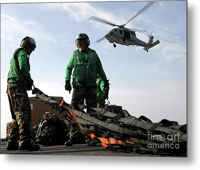 An Mh-60s Seahawk Passes Over Two Metal Print by Stocktrek Images