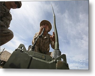 An Officer Conducts A Radio Check Metal Print by Stocktrek Images