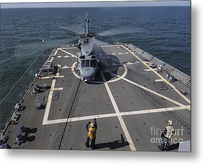 An Sh-60b Sea Hawk Lands On The Flight Metal Print by Stocktrek Images