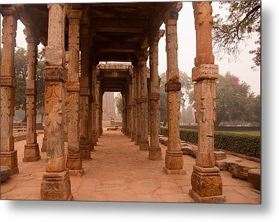Artistic Pillars Are All That Remain Of This Old Monument Inside The Qutub Minar Complex Metal Print by Ashish Agarwal
