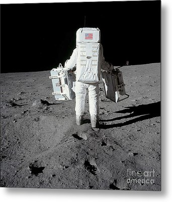 Astronaut Carrying Equipment Metal Print by Stocktrek Images