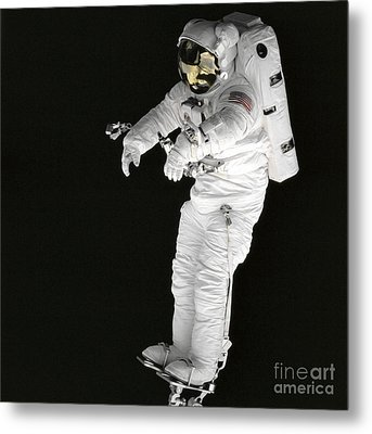 Astronaut Stands On A Portable Foot Metal Print by Stocktrek Images