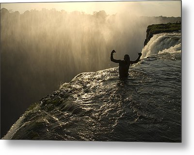 Bathing In A Swimming Hole At The Top Metal Print by Annie Griffiths