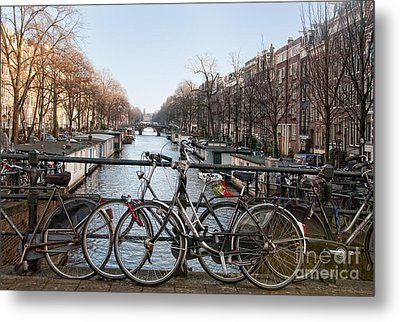 Metal Print featuring the digital art Bikes On The Canal In Amsterdam by Carol Ailles