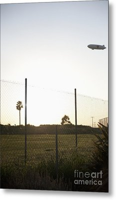 Blimp Flying Over Sports Field Metal Print by Sam Bloomberg-rissman