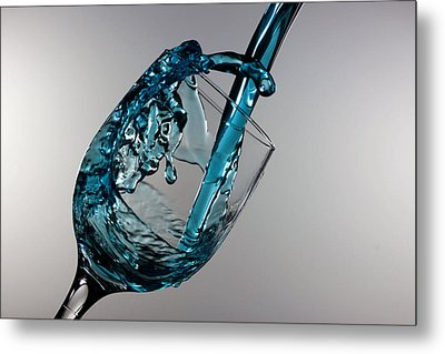 Blue Martini Splashing From A Wine Glass Metal Print by Paul Ge