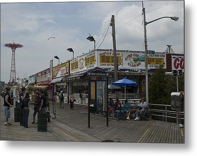 Boardwalk At Coney Island On A Cloudy Metal Print by Todd Gipstein
