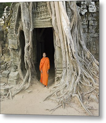 Buddhist Monk Standing Next To Tree Roots Metal Print by Martin Puddy