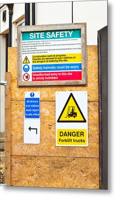 Building Site Signs Metal Print by Tom Gowanlock