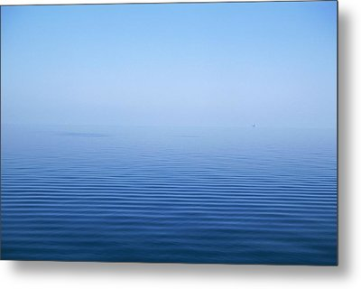 Calm Blue Water Disappearing Into Metal Print by Axiom Photographic