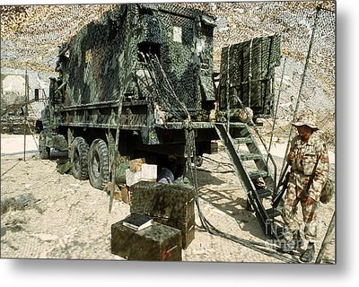 Camouflage Netting Covers A Cargo Truck Metal Print by Stocktrek Images