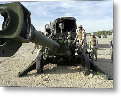 Cannoneers Train With The M777 Metal Print by Stocktrek Images