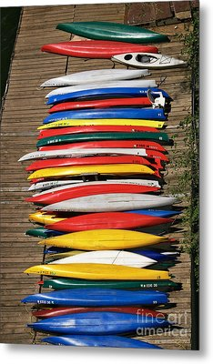 Canoes On A Dock Metal Print by Susan Isakson