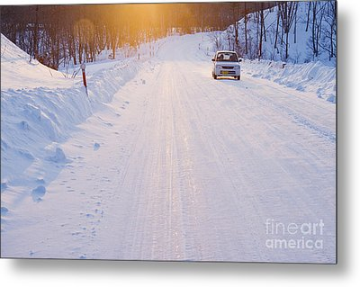Car On Snow Covered Road Metal Print by Jeremy Woodhouse