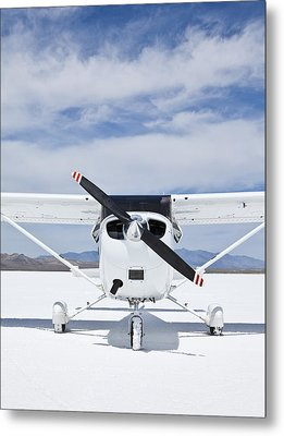 Cessna Aircraft On Bonneville Salt Flats Metal Print by Paul Edmondson