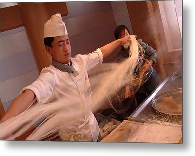 Chef Stretches Dough As He Makes Fresh Metal Print by Richard Nowitz