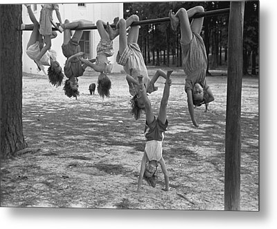Children Playing At A Playground Metal Print by Everett
