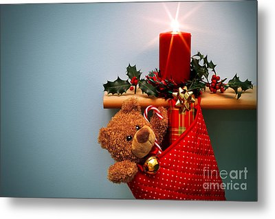Christmas Stocking Filled With Presents With Candle And Holly. Metal Print by Richard Thomas