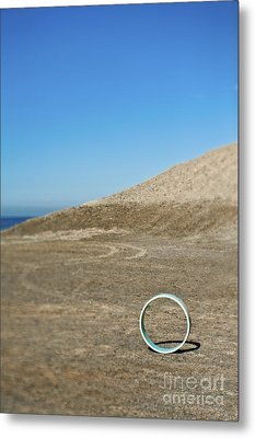 Circular Object On Beach Metal Print by Eddy Joaquim