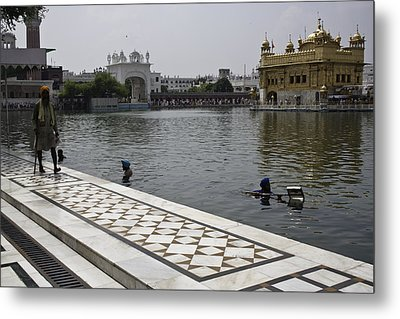 Clearing The Sarovar Inside The Golden Temple Resorvoir Metal Print by Ashish Agarwal