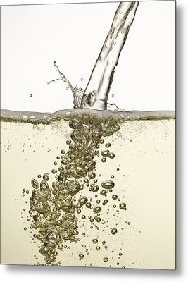 Close Up Of Champagne Being Poured Metal Print by Andy Roberts