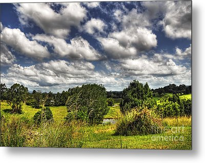 Clouds Floating Over Green Countryside Metal Print by Kaye Menner