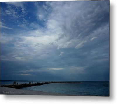 Clouds Over The Jetty Metal Print by Grace Dillon