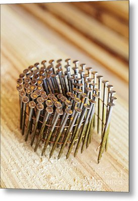Coiled Framing Nails Metal Print by Skip Nall