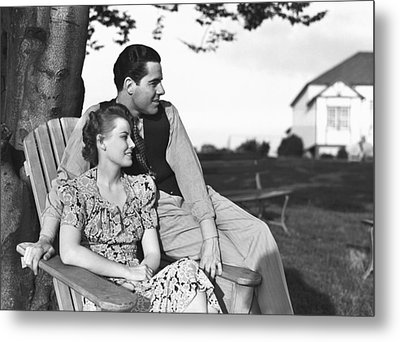 Couple Relaxing On Deckchair In Garden, (b&w) Metal Print by George Marks