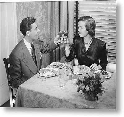 Couple Toasting At Dinner Table, (b&w), Elevated View Metal Print by George Marks