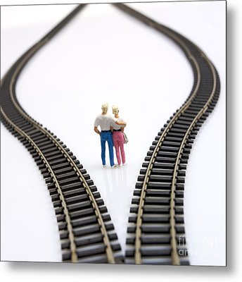 Couple Two Figurines Between Two Tracks Leading Into Different Directions Symbolic Image For Making Decisions Metal Print by Bernard Jaubert