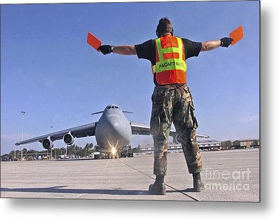 Crew Chief Marshals A C-5 Galaxy Metal Print by Stocktrek Images