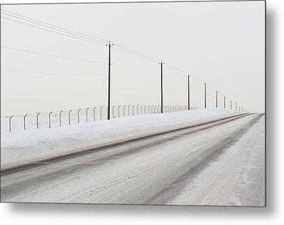 Desolate Winter Road Metal Print by Lynn Koenig