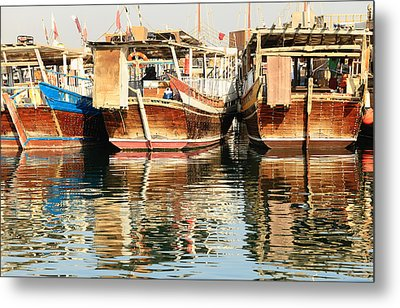 Dhow Reflections Metal Print by Paul Cowan