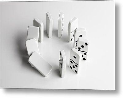 Dominoes In A Circle Beginning To Fall Over In A Chain Reaction Metal Print