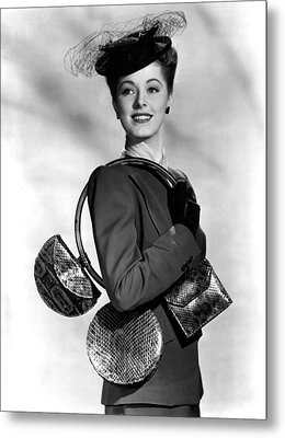 Eleanor Parker Carrying 3 Small Metal Print by Everett