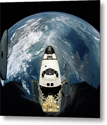 Elevated View Of A Spacecraft Orbiting Over The Earth Metal Print by Stockbyte
