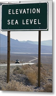 Elevation Sea Level Sign And Highway Metal Print by Rich Reid