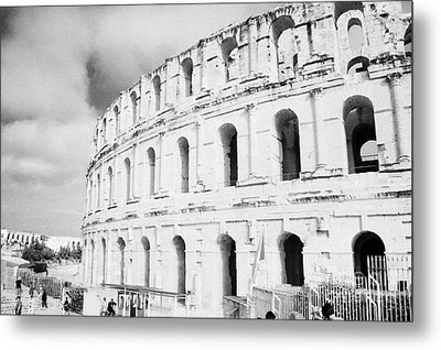 Entrance And Front Of The The Old Roman Colloseum Against Blue Cloudy Sky El Jem Tunisia Metal Print by Joe Fox