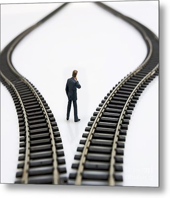 Figurine Between Two Tracks Leading Into Different Directions  Symbolic Image For Making Decisions Metal Print by Bernard Jaubert
