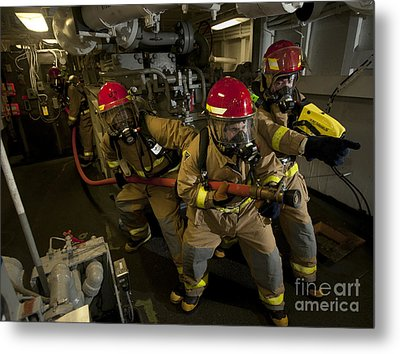 Firemen Combat A Simulated Fire Aboard Metal Print by Stocktrek Images