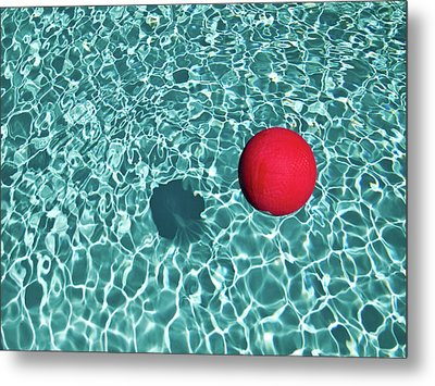 Floating Red Ball In Blue Rippled Water Metal Print by Mark A Paulda