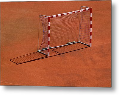 Football Net On Red Ground Metal Print by Daniel Kulinski