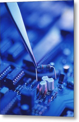 Forceps Holding A Resistor Over A Circuit Board Metal Print by Chris Knapton