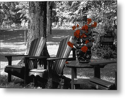 Garden Chairs With Red Flowers In A Pot Metal Print by David Chapman