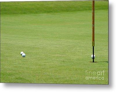 Golf Balls Near Flagstick Metal Print by Henrik Lehnerer