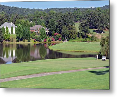 Golfer At Lake  Metal Print by Susan Leggett