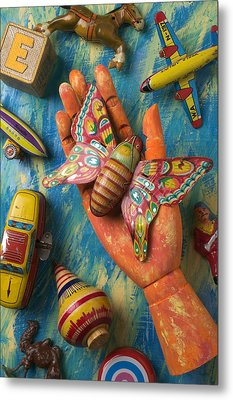 Hand Holding Butterfly Toy Metal Print by Garry Gay