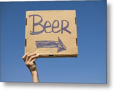 Hand Holding Up Makeshift 'beer' Sign Metal Print by Pete Starman